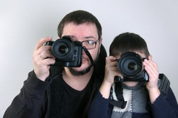 Father and son with cameras
