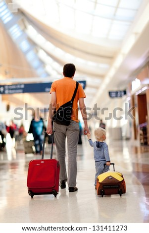 father and son with the luggage at the airport