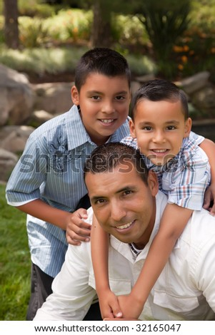 Father and Sons Portrait in the Park.