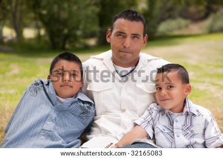 Father and Sons Portrait in the Park. - stock photo