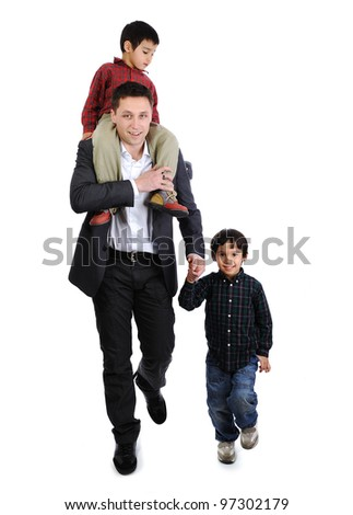 Father and sons taking a walk
