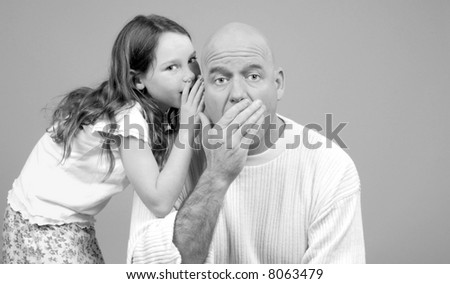 Father Being Told Secret by Daughter
