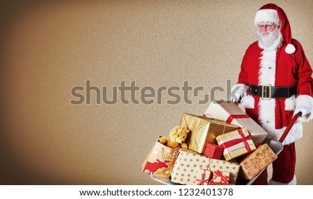 Father Christmas delivering a wheelbarrow of colorful wrapped gifts over a brown gradient background with copy space