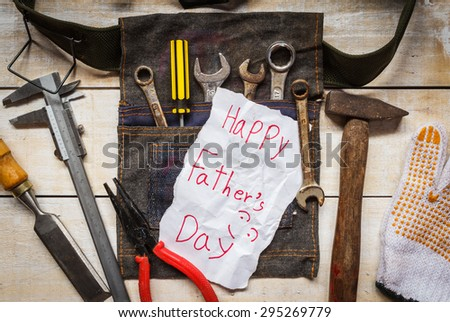 father day paper card with tool  from kid on wood