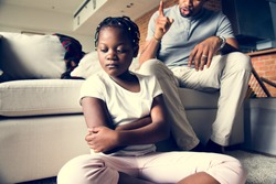 Father disciplining his daughter