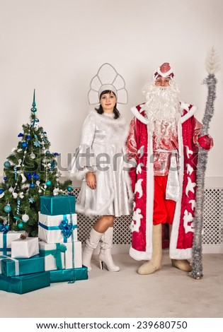 Father Frost and the Snow Maiden give gifts.