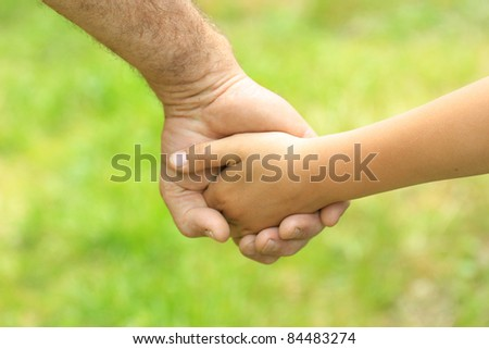 father gives her hand a child