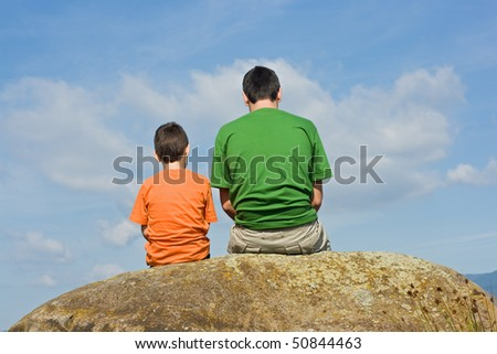 Father giving some advices to his son - the big talk concept
