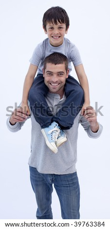 Father giving son piggyback ride against white background