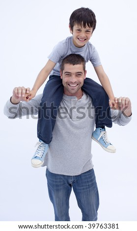 Father giving son piggyback ride at home
