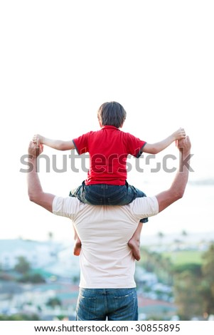Father giving son piggyback ride outdoors