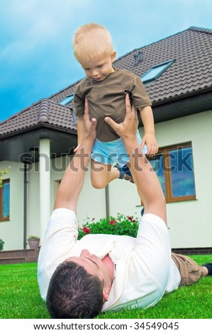 Father having fun with a baby in yard
