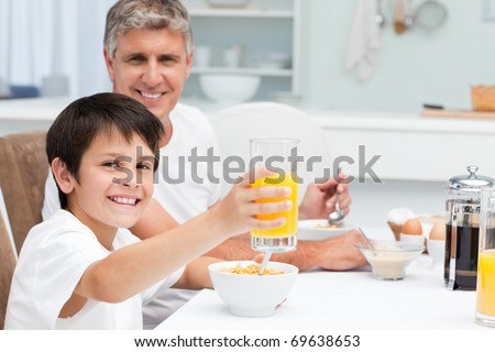 Father having his breakfast with his son at home