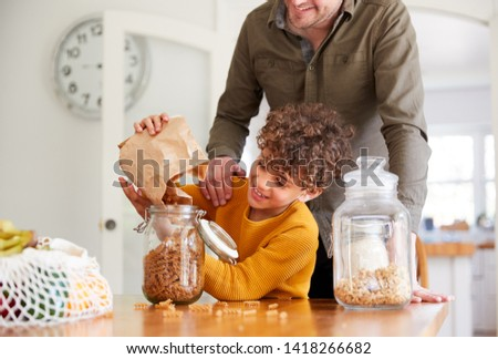 Father Helping Son To Refill Food Containers At Home Using Zero Waste Packaging #1418266682