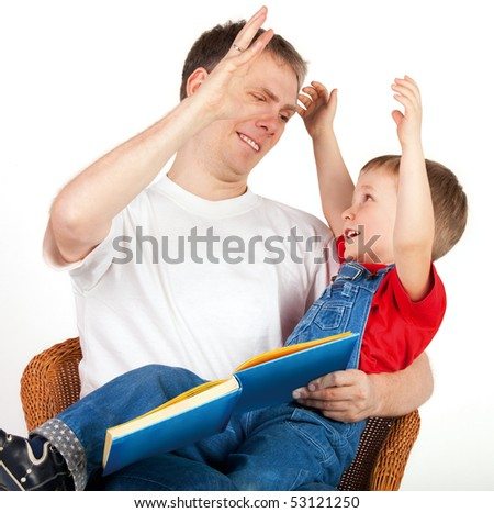 Father high-fives with his son on white background