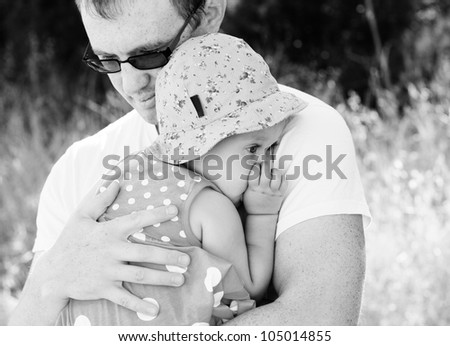 father holding his daughter