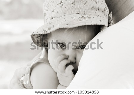father holding his daughter, focus on the eyes