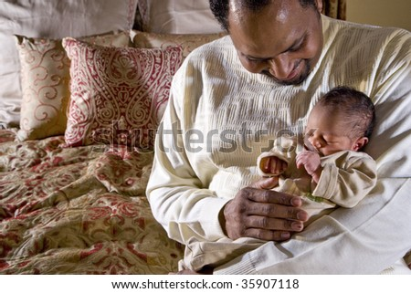 Father holding newborn baby