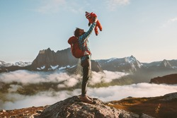 Father holding up baby hiking in mountains family fun travel vacation with child active healthy lifestyle man and infant outdoor Fathers day holiday