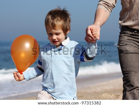 father holds the hand of his son