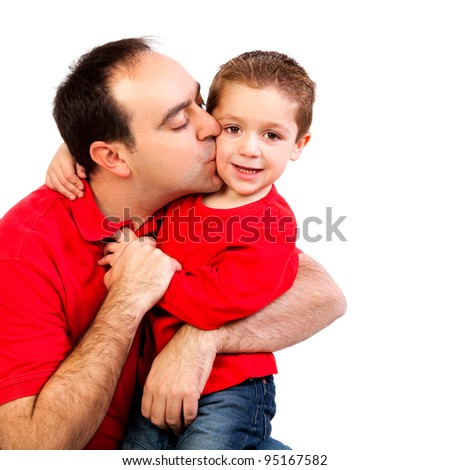 Father kissing his son isolated on white