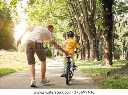 Shutterstock Father learn his little son to ride a bicycle