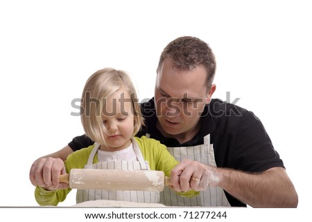 father learning his little girl how to make a cake