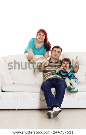 Father, mother and son sitting on the sofa showing hand ok sign over white background