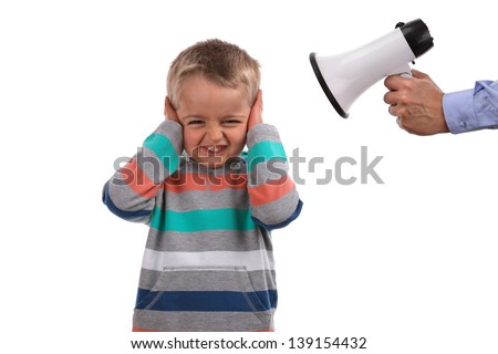 Father or teacher telling off son or pupil by shouting through a megaphone whilst his hands covering ears not listening