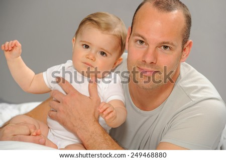 Father playing with his little baby. Quality time father and daughter. #249468880