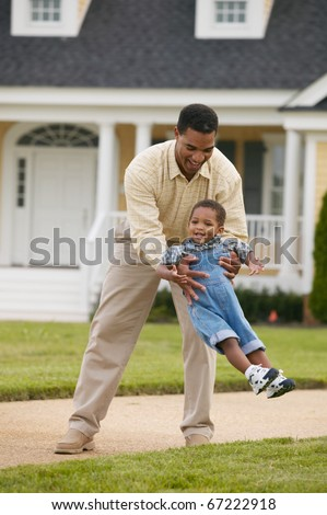 Father playing with young son - stock photo