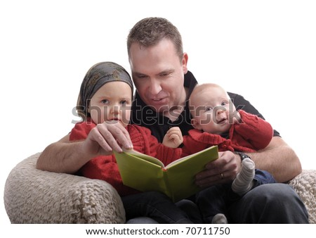 Father reading a story at his little daughters. Isolated on white