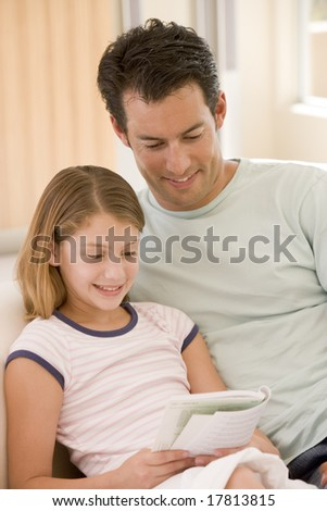 Father reading book with daughter