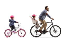 Father riding a bicycle with a child seat and a little girl riding a bicycle behind isolated on white background