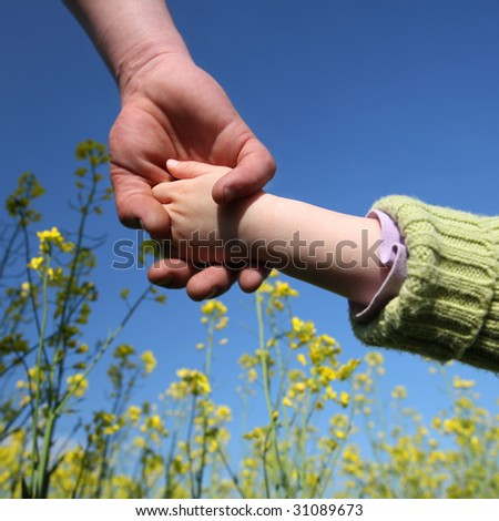 father's and daughter's hands