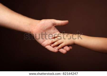father's and son's hands. soft focus