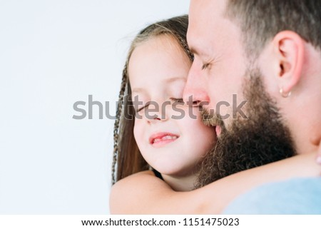 father's care and loving heart. parent and kid bond. portrait of daddy embracing his little child girl. family happiness. #1151475023