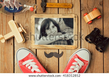 Father\'s day background with photo in wooden frame. View from above. Flat lay