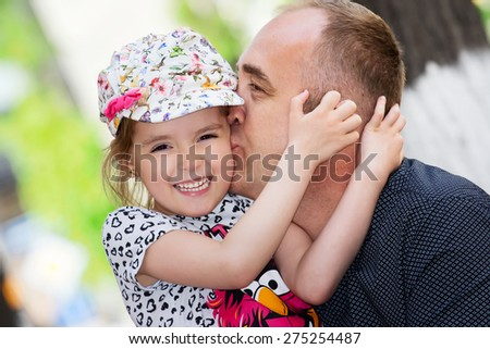 Father\'s day. Dad kissing his daughter.Happy smiling child with parent. Family portrait.