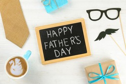 Father's day greeting card concept. Close up composition with symbolic objects on textured background with a lot of copy space for text. Top view, flat lay.