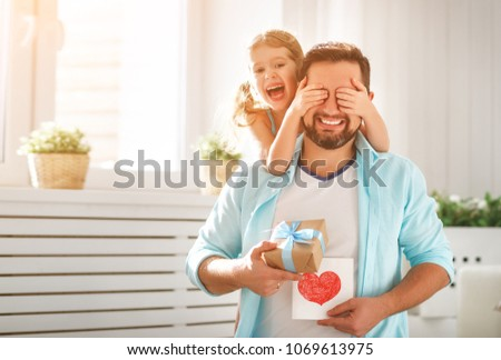 Father's day. Happy family daughter hugging dad and laughs on holiday #1069613975