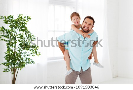 Father's day. Happy family daughter hugging dad and laughs on holiday #1091503046