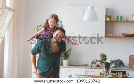 Father's day. Happy family daughterhugs his dad  on holiday