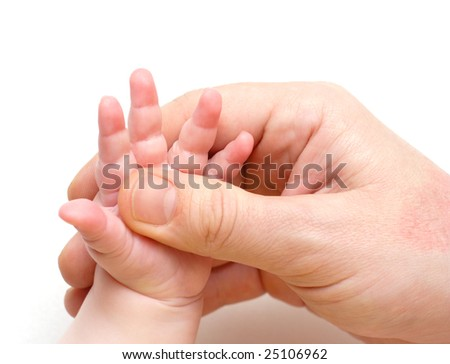 father`s hand holding a little baby`s hand