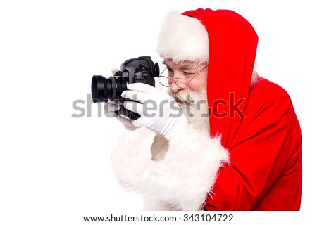 Father santa taking christmas picture