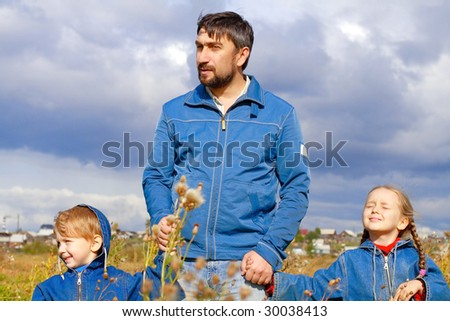 Father, son and daughter dressed in jeans - stock photo