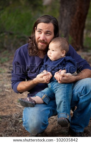 Father & son having a day of fun in the nature