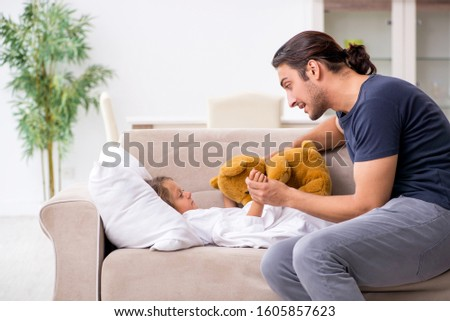 Father taking care of his ill daughter