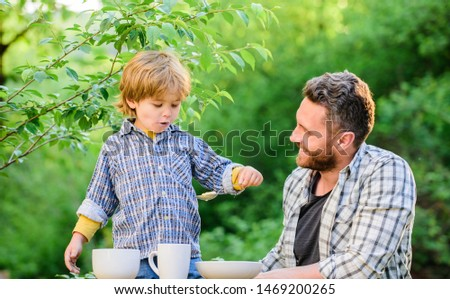 Father teach son eat natural food. Little boy and dad eat. Organic nutrition. Healthy nutrition concept. Nutrition habits. Family enjoy homemade meal. Personal example. Nutrition kids and adults.
