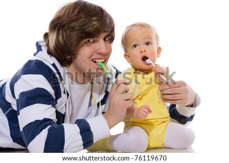 Father teaching baby brushing teeth isolated on white